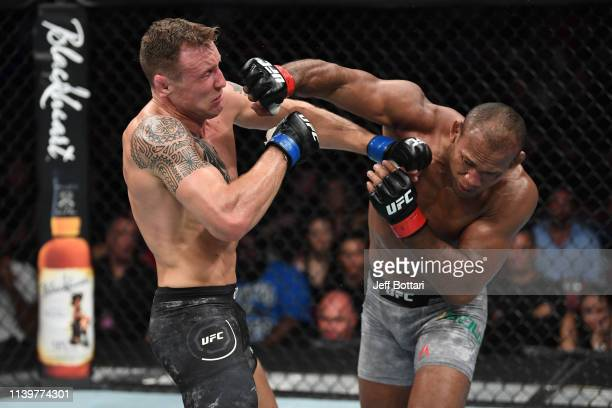 Jacare Souza of Brazil punches Jack Hermansson of Sweden in their middleweight bout during the UFC Fight Night event at BB&T Center on April 27, 2019...