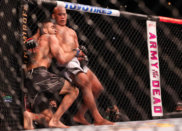 Jacare Souza wrestles with Andre Muniz during their Middleweight Bout of UFC 262 at Toyota Center on May 15, 2021 in Houston, Texas.