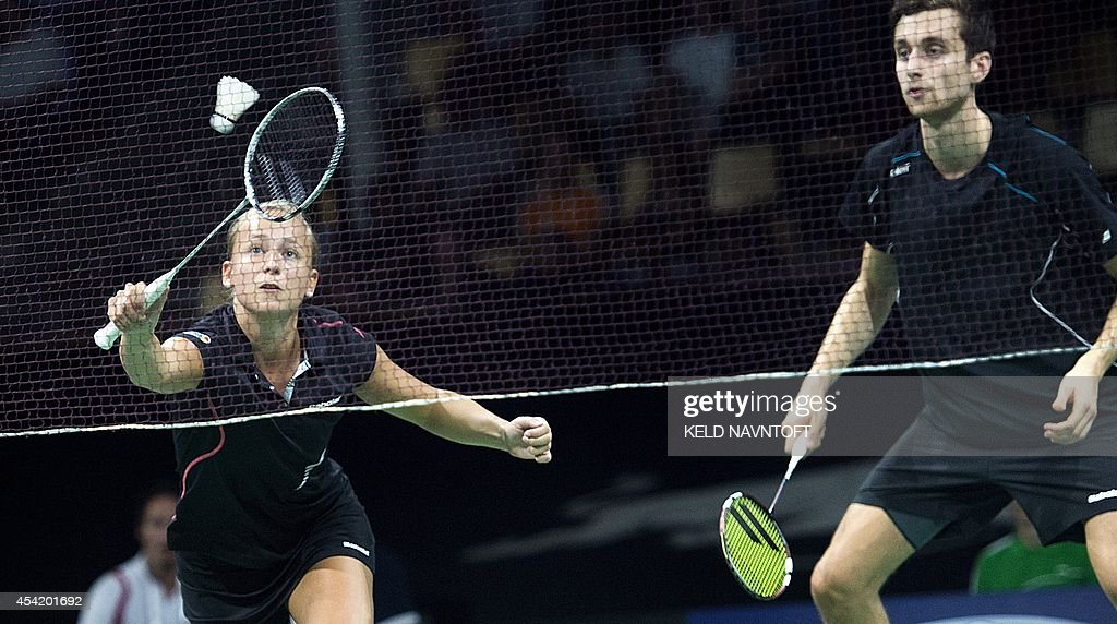 Jacco Arends (R) and Selena Piek from the Netherlands play against Joachim Fischer Nielsen and Christinna Pedersen (not in picture) from Demark during their match at the 2014 BWF Badminton World championships held at the Ballerup Super Arena in Copenhagen on August 26, 2014.