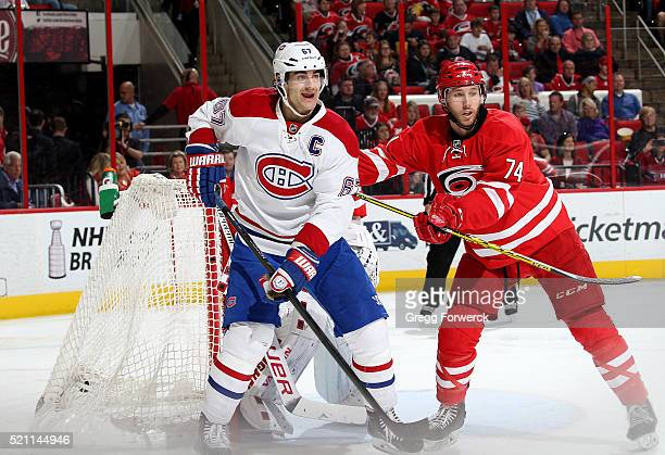 Jaccob Slavin of the Carolina Hurricanes battles near the crease with Max Pacioretty of the Montreal Canadiens during an NHL game at PNC Arena on...