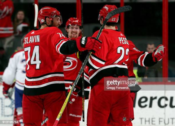 Jaccob Slavin of the Carolina Hurricanes celebrates a goal scored by Brett Pesce against the Montreal Canadiens during an NHL game on February 1 2018...