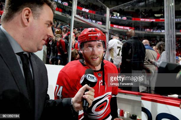 Jaccob Slavin of the Carolina Hurricanes is interviewed by Fox sports game night host Mike Maniscalco during an NHL game against the Pittsburgh...