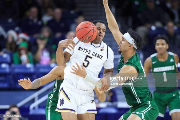 Jace Hogan of the Jacksonville Dolphins knocks the ball away from DJ Harvey of the Notre Dame Fighting Irish in the second half at Purcell Pavilion...
