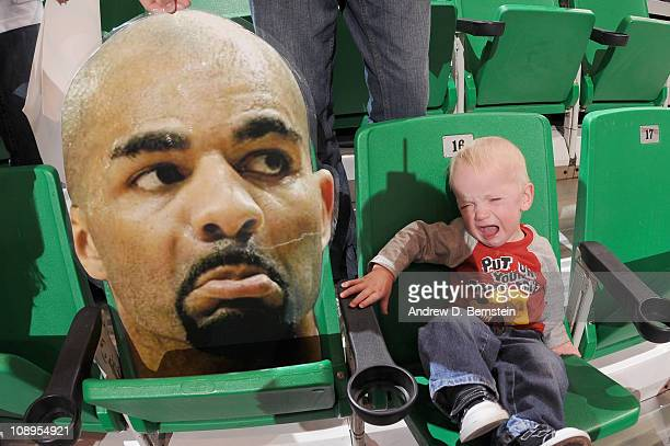 Jace Iverson a young fan of the Utah Jazz cries next to the head sign of Carlos Boozer of the Chicago Bulls at EnergySolutions Arena on February 9...
