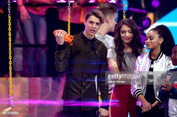 Jace Norman accepts the Favorite TV Actor award for 'Henry Danger' from Owen Joyner Lilimar Hernandez and Daniella Perkins onstage at Nickelodeon's...