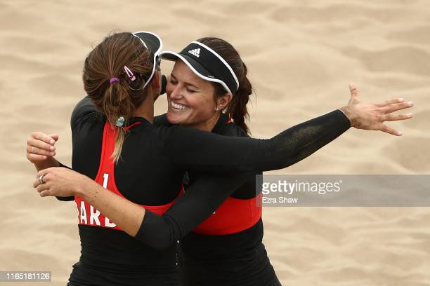 Jace Pardon of United States and Karissa Cook of United States celebrate celebrate after defeating Argentina in women's beach volleyball gold medal...