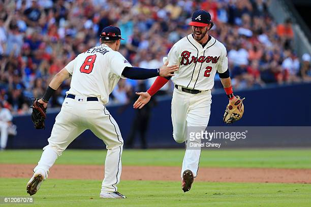 Jace Peterson and Dansby Swanson of the Atlanta Braves celebrate a line drive double play in the eighth inning against the Detroit Tigers at Turner...