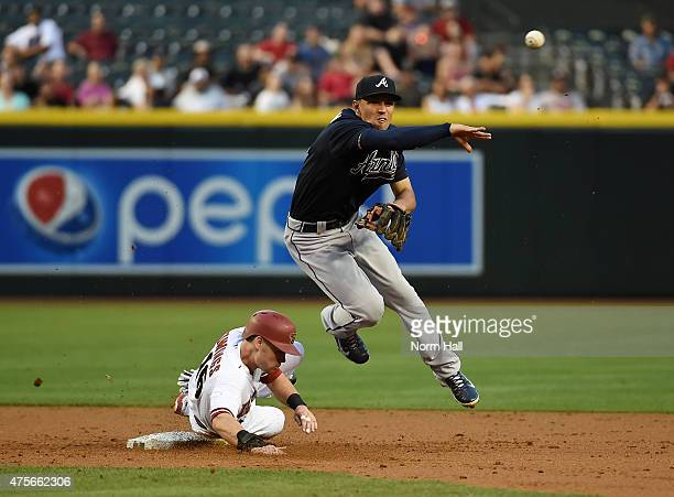 Jace Peterson of the Atlanta Braves attempts to turn a double play while avoiding the slide by Chris Owings of the Arizona Diamondbacks during the...
