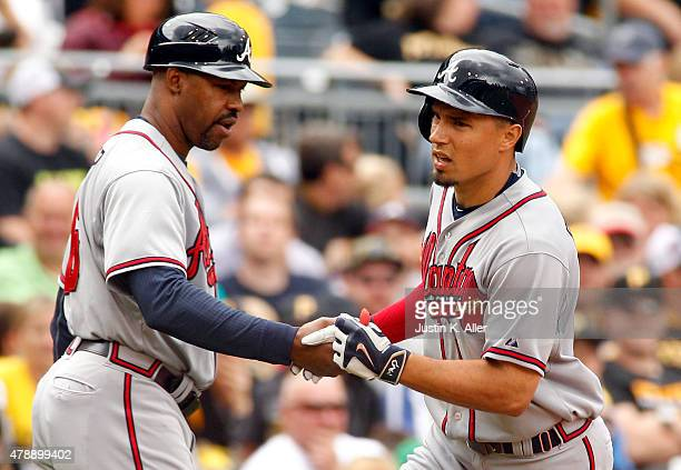 Jace Peterson of the Atlanta Braves celebrates with third base coach Bo Porter after hitting a home run in the seventh inning during the game against...