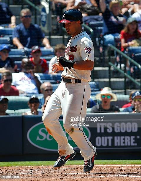 Jace Peterson of the Atlanta Braves crosses homeplate on a RBI single hit by Nick Markakis in the fifth inning against the New York Mets at Turner...