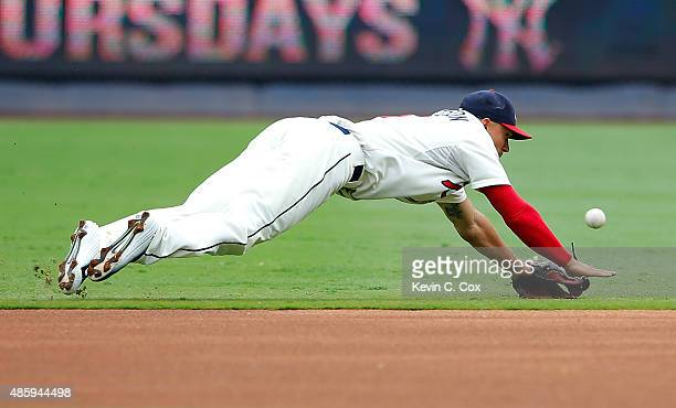 Jace Peterson of the Atlanta Braves dives but fails to catch a single hit by Jacoby Ellsbury of the New York Yankees in the first inning at Turner...