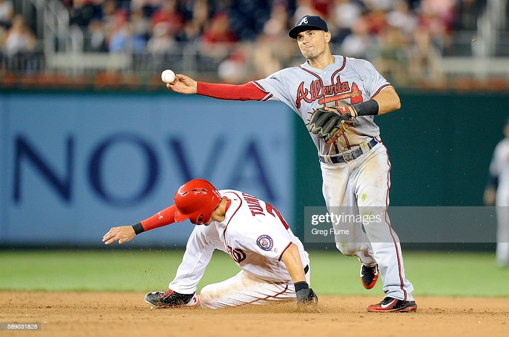 Jace Peterson #8 of the Atlanta Braves forces out Trea Turner #7 of the Washington Nationals to start a double play in the ninth inning against the at Nationals Park on August 12, 2016 in Washington, DC. Atlanta won the game 8-5.