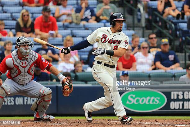 Jace Peterson of the Atlanta Braves hits an RBI single in the second inning against the Atlanta Braves at Turner Field on September 18 2016 in...