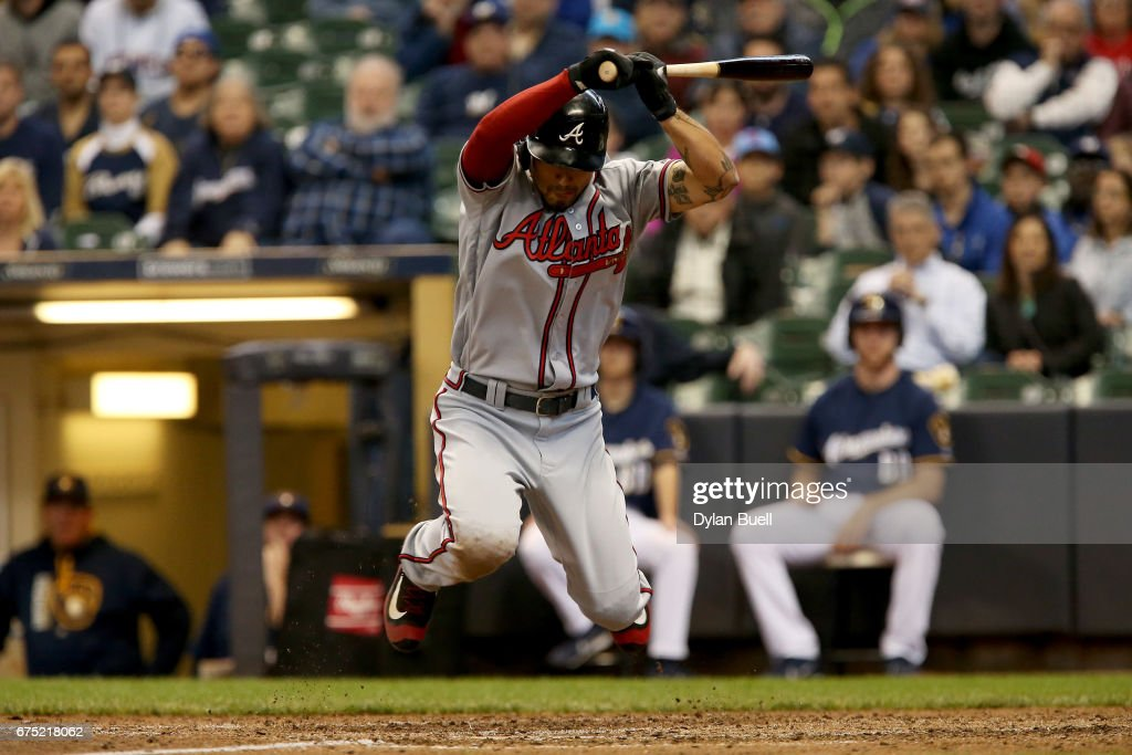 Jace Peterson #8 of the Atlanta Braves leaps to avoid being hit by a pitch in the ninth inning against the Milwaukee Brewers at Miller Park on April 30, 2017 in Milwaukee, Wisconsin.