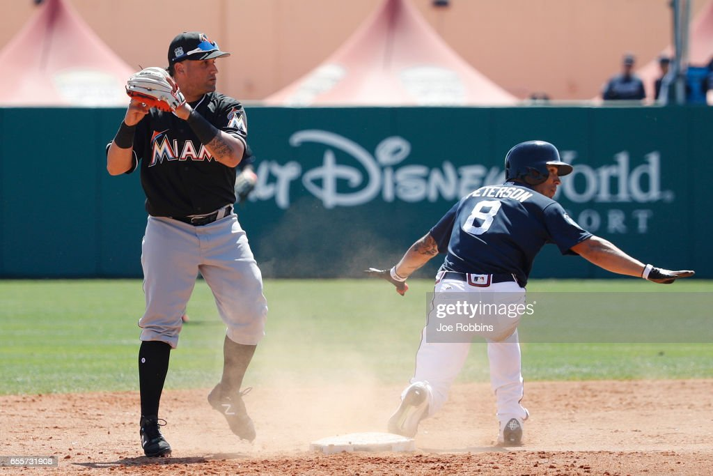Jace Peterson #8 of the Atlanta Braves reacts after being tagged out by David Vidal #93 of the Miami Marlins trying to reach second base after a single in the sixth inning of a Grapefruit League spring training game at Champion Stadium on March 20, 2017 in Lake Buena Vista, Florida. The Marlins defeated the Braves 9-3.