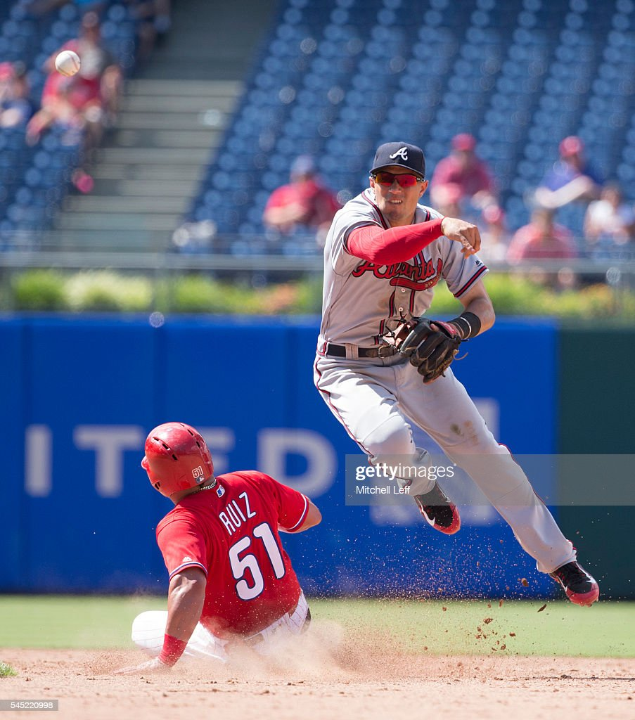 Jace Peterson #8 of the Atlanta Braves turns a double play against Carlos Ruiz #51 of the Philadelphia Phillies in the bottom of the eighth inning at Citizens Bank Park on July 6, 2016 in Philadelphia, Pennsylvania. The Phillies defeated the Braves 4-3.