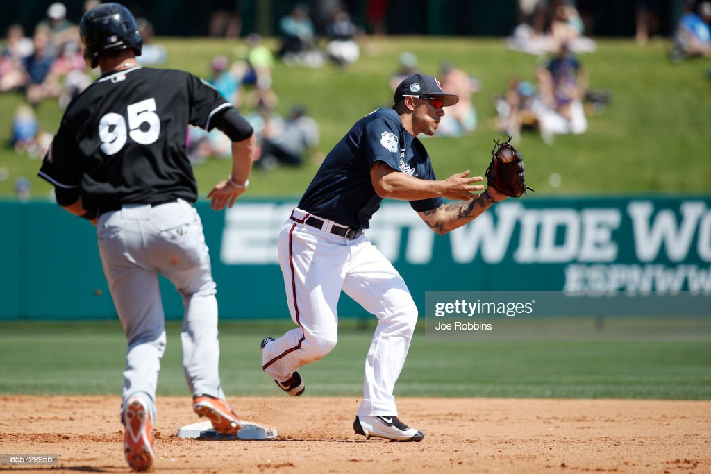 Jace Peterson #8 of the Atlanta Braves turns a double play ahead of Zach Sullivan #95 of the Miami Marlins in the sixth inning of a Grapefruit League spring training game at Champion Stadium on March 20, 2017 in Lake Buena Vista, Florida. The Marlins defeated the Braves 9-3.