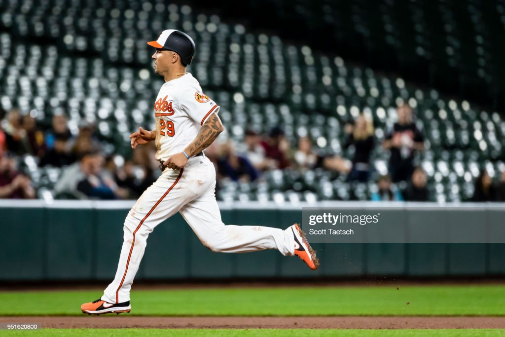 Jace Peterson #29 of the Baltimore Orioles advances to third on a single off the bat of Adam Jones (not pictured) during the seventh inning against the Tampa Bay Rays at Oriole Park at Camden Yards on April 26, 2018 in Baltimore, Maryland.