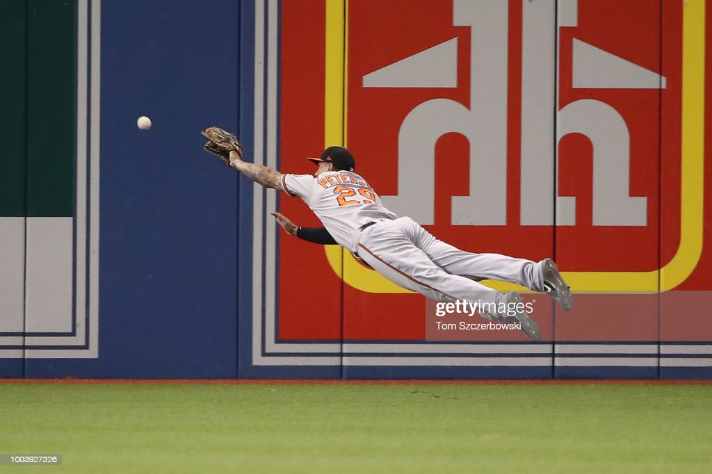 Jace Peterson #29 of the Baltimore Orioles dives but cannot get to an RBI double hit by Yangervis Solarte #26 of the Toronto Blue Jays in the fourth inning during MLB game action at Rogers Centre on July 22, 2018 in Toronto, Canada.