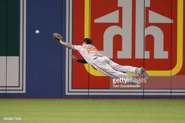 Jace Peterson of the Baltimore Orioles dives but cannot get to an RBI double hit by Yangervis Solarte of the Toronto Blue Jays in the fourth inning...
