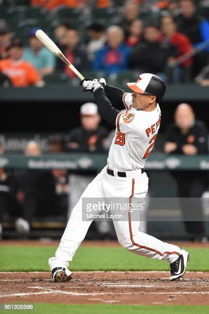 Jace Peterson of the Baltimore Orioles doubles in two runs in the second inning during a baseball game against the Tampa Bay Rays at Oriole Park at...