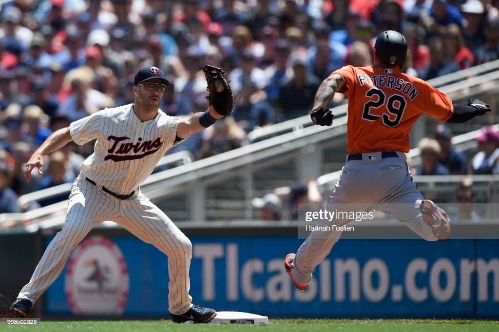 Jace Peterson #29 of the Baltimore Orioles is out at first base as Joe Mauer #7 of the Minnesota Twins fields the ball during the second inning of the game on July 7, 2018 at Target Field in Minneapolis, Minnesota.