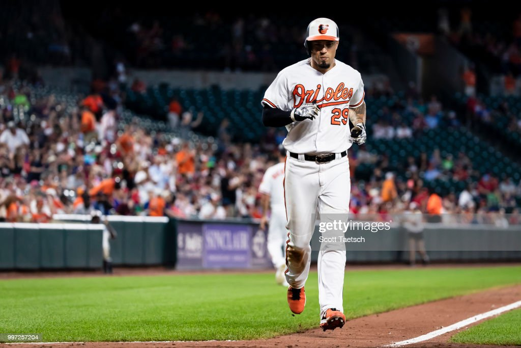 Jace Peterson #29 of the Baltimore Orioles scores against the Philadelphia Phillies during the seventh inning at Oriole Park at Camden Yards on July 12, 2018 in Baltimore, Maryland.