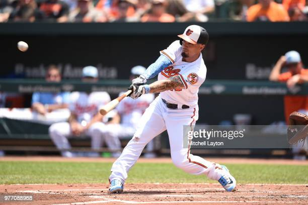 Jace Peterson of the Baltimore Orioles singles knocking in Jonathan Schoop in the second inning during a baseball game against the Miami Marlins at...