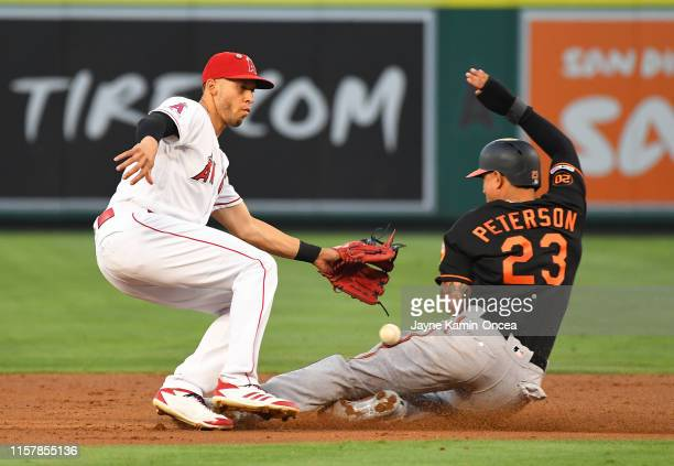 Jace Peterson of the Baltimore Orioles steals second as the throw gets by Andrelton Simmons of the Los Angeles Angels in the second inning of the...