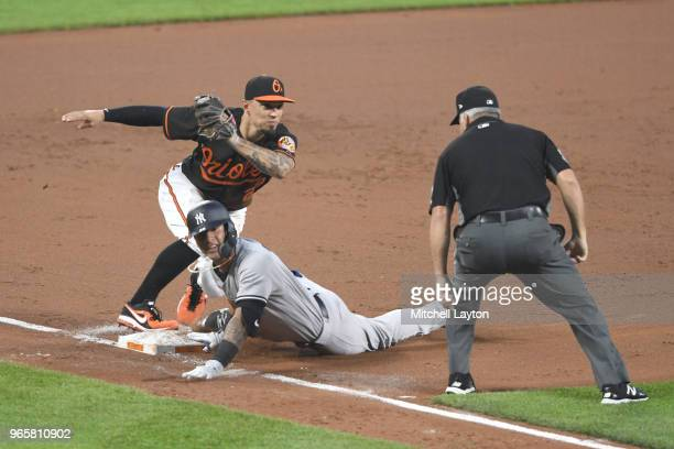 Jace Peterson of the Baltimore Orioles tags out Gleyber Torres of the New York Yankees trying to stretch a double into a triple in the fifth inning...