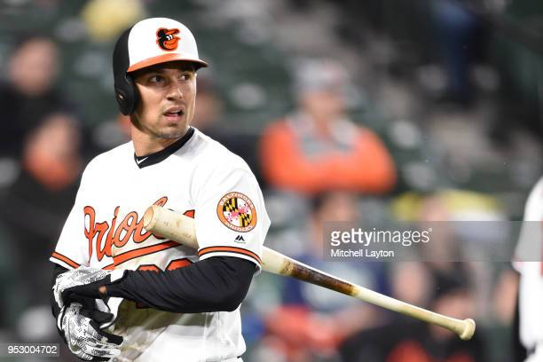 Jace Peterson of the Baltimore Orioles walks back to the dug out during a baseball game against the Tampa Bay Rays at Oriole Park at Camden Yards on...