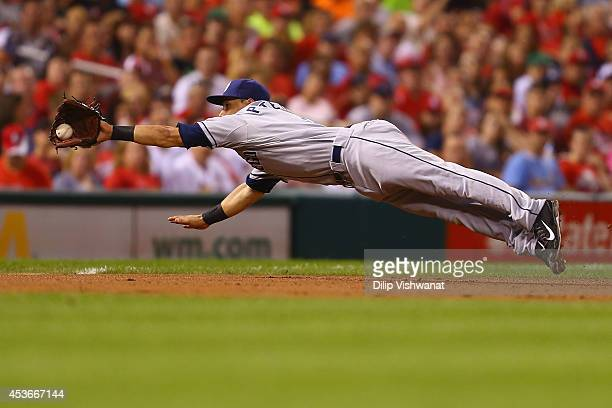 Jace Peterson of the San Diego Padres fields a ground ball against the St Louis Cardinals in the fifth inning at Busch Stadium on August 15 2014 in...