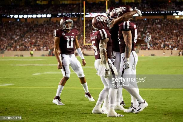 Jace Sternberger of the Texas AM Aggies celebrates with his teammates after scoring on a 7 yard touchdown reception against the Northwestern State...