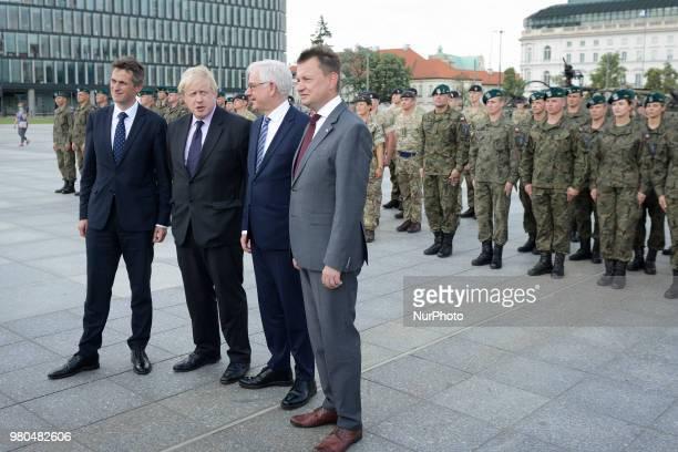 Jacek CzaputowiczBoris JohnsonGavin WilliamsonMariusz Blasczak visit Warsaw Poland on June 21 2018 to meet with Polish minister of defence Mariusz...