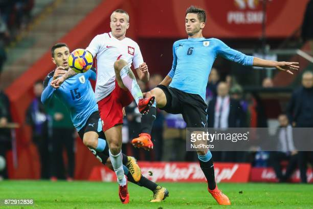 Jacek Goralski Rodrigo Bentancur Matias Vecino in action during the international friendly match between Poland and Uruguay at National Stadium on...