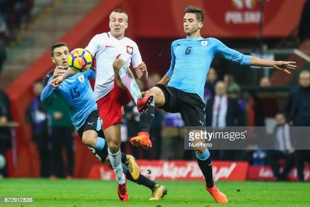 Jacek Goralski Rodrigo Bentancur Matias Vecino in action during the international friendly match between Poland and Uruguay at National Stadium on...