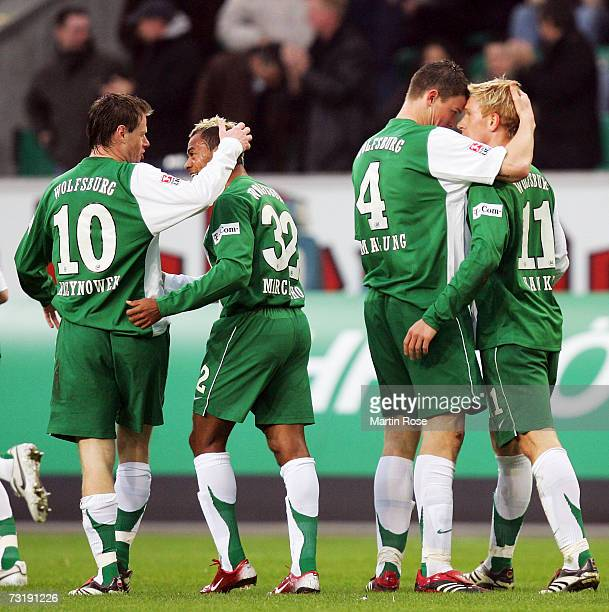 Jacek Kryznowek Marcelinho Alexander Madlund and Mike Hanke of Wlfsburg celebrate the 1st goal during the Bundesliga match between VFL Wolfsburg and...