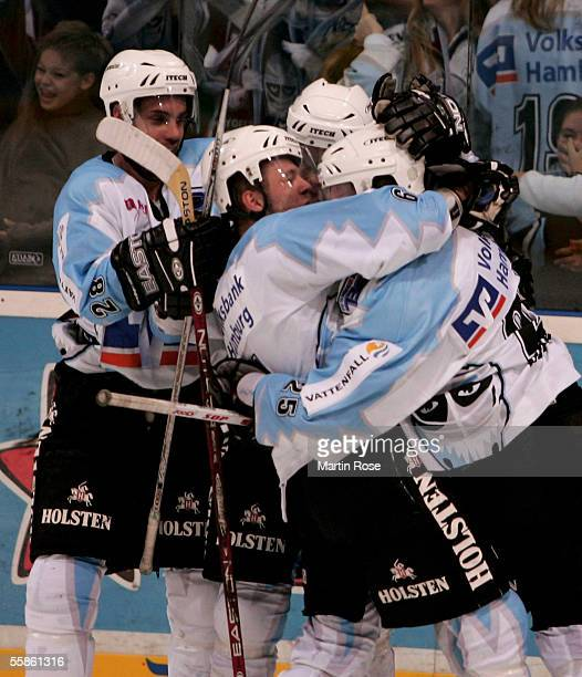 Jacek Plachta Alexander Barta and Alan Letang of Hamburg celebrate scoring the second goal during the DEL match between Hamburg Freezers and...