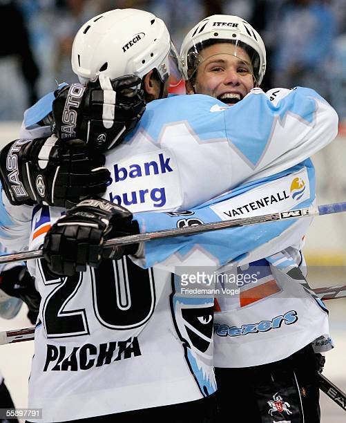 Jacek Plachta celebrates scoring the fourth goal with Alexander Barta of Freezers during the first goal during the DEL Bundesliga match between...