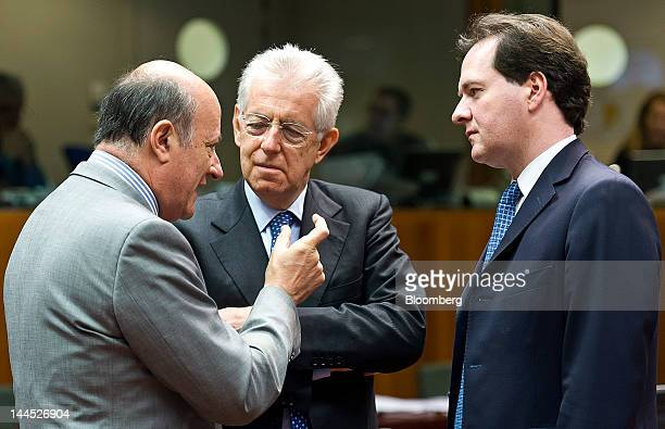 Jacek Rostowski Poland's finance minister left gestures as he speaks with Mario Monti Italy's prime minister center and George Osborne UK chancellor...