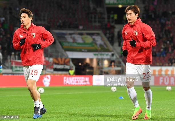 Ja-Cheol Koo and Dong-Won Ji of FC Augsburg warm up prior to the Bundesliga match between FC Augsburg and RB Leipzig at WWK Arena on March 3, 2017 in...