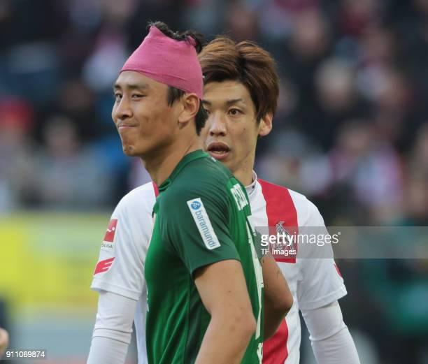 JaCheol Koo of Augsburg and Yuya Osako of Koeln looks on during the Bundesliga match between 1 FC Koeln and FC Augsburg at RheinEnergieStadion on...