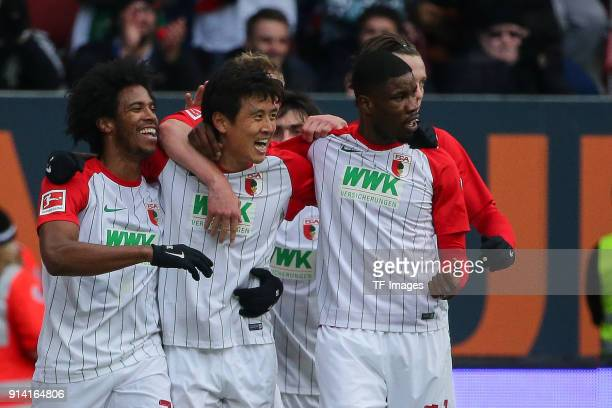 JaCheol Koo of Augsburg celebrates after scoring his team`s first goal with team mates during the Bundesliga match between FC Augsburg and Eintracht...