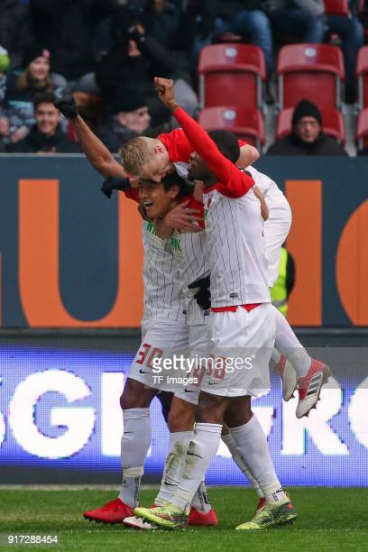 JaCheol Koo of Augsburg celebrates after scoring his team`s first goal with Francisco da Silva Caiuby of Augsburg Martin Hinteregger of Augsburg and...