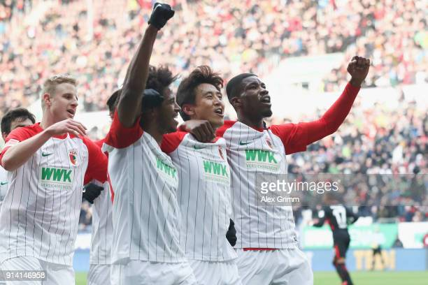 Jacheol Koo of Augsburg celebrates his team's first goal with team mates Kevin Danso and Caiuby during the Bundesliga match between FC Augsburg and...