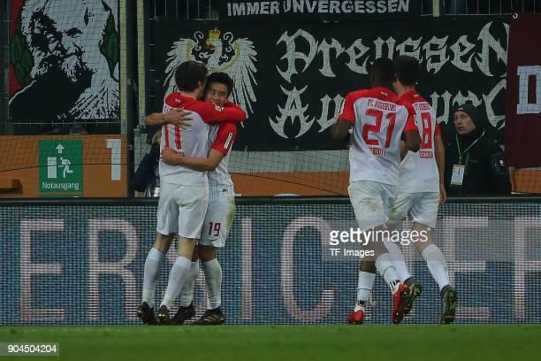 JaCheol Koo of Augsburg celebrates with Michael Grogoritsch of Augsburg Sergio Cordova of Augsburg and Rani Khedira of Augsburg after scoring his...