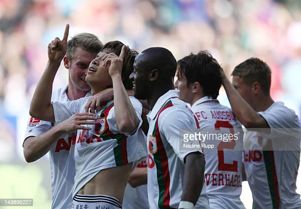 JaCheol Koo of Augsburg celebrates with team mates after scoring a goal during the Bundesliga match between FC Augsburg and Hamburger SV at SGL Arena...