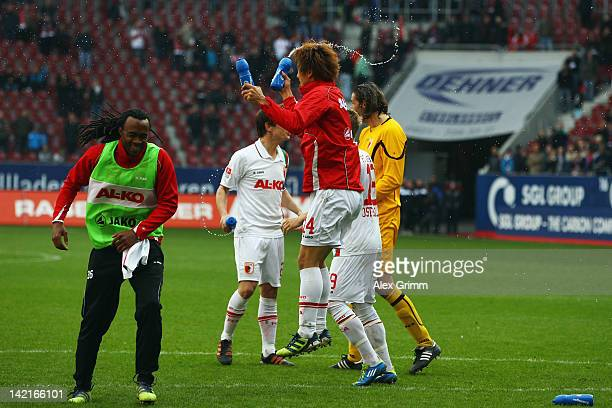 Ja-Cheol Koo of Augsburg celebrates with team mates after the Bundesliga match between FC Augsburg and 1. FC Koeln at SGL Arena on March 31, 2012 in...