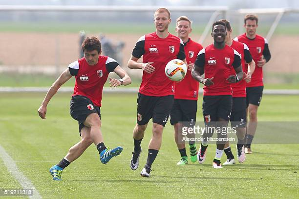 JaCheol Koo of Augsburg controls the ball during a FC Augsburg Training session at WWK Arena on April 5 2016 in Augsburg Germany