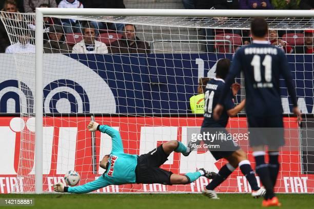 JaCheol Koo scores his team's first goal against goalkeeper Michael Rensing of Koeln during the Bundesliga match between FC Augsburg and 1 FC Koeln...